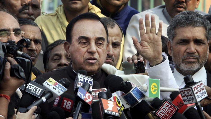 Indian lawmaker Subramanian Swamy, center, speaks to the media outside the Supreme Court in New Delhi on Feb. 2, 2012. (AP Photo)