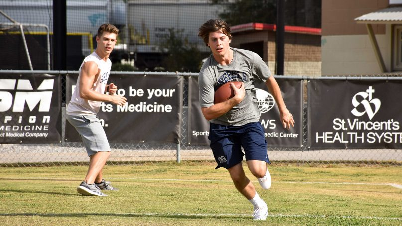"""The Truett brothers Dave (Evan Hofer), left,  and Zach (Tanner Stine) run football drills in the movie """"Run The Race,"""" which opens in theaters on Feb. 22, 2019. Photo courtesy of RTR Movie Holdings, LLC."""