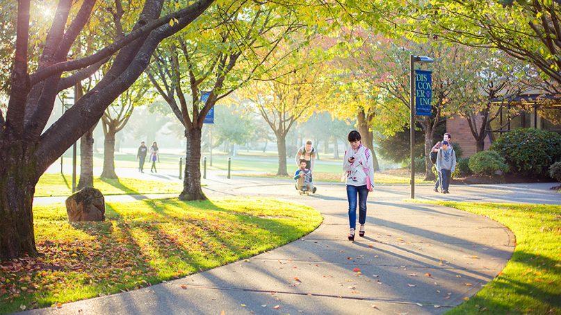 Late-day sun illuminates people on the Trinity Western University campus in Langley, British Columbia. Photo courtesy of TWU