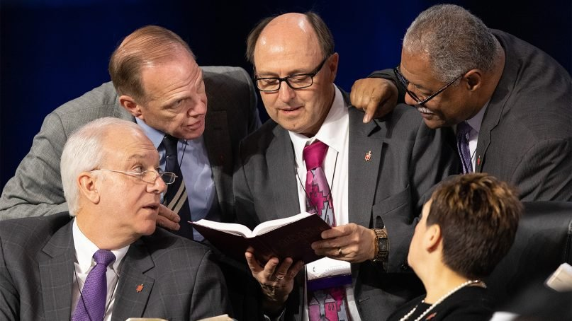 Bishops confer over the issue of whether the legislative committee can refer items to the denomination's Judicial Council for review during the 2019 United Methodist General Conference in St. Louis, Mo. on Feb. 25, 2019. Clockwise from lower left are Bishops Thomas Bickerton, John Schol, David Bard, Julius C. Trimble and Cynthia Fierro Harvey. Photo by Mike DuBose/UMNS