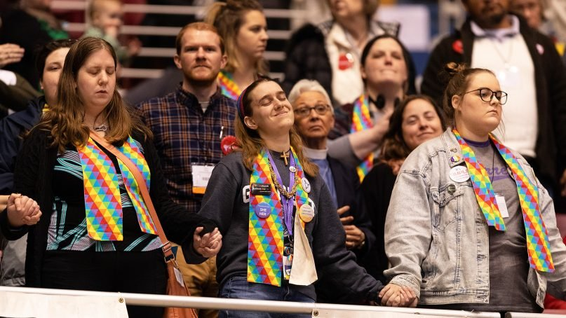Supporters of full inclusion for LGBTQ people in United Methodist Church life hold hands in the observers' area at the 2019 United Methodist General Conference in St. Louis on Feb. 25, 2019, while waiting for vote totals to be displayed. Photo by Mike DuBose/UMNS