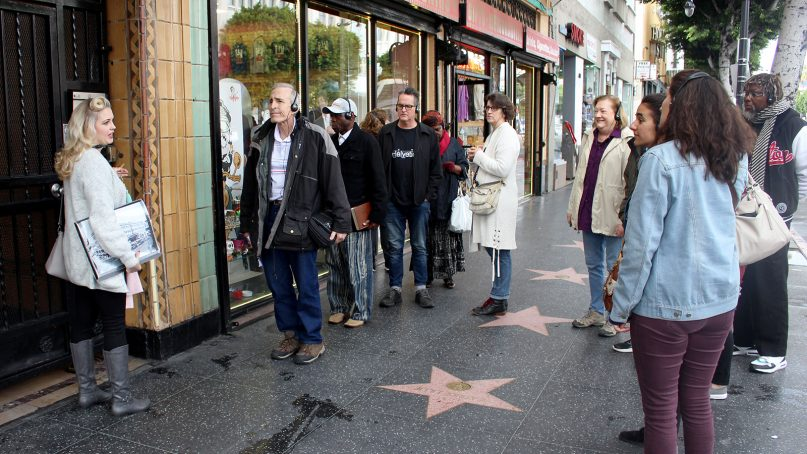 April Clemmer, left, leads a Walk of Faith tour group through Hollywood in Los Angeles on Feb. 9, 2019. RNS photo by Heather Adams