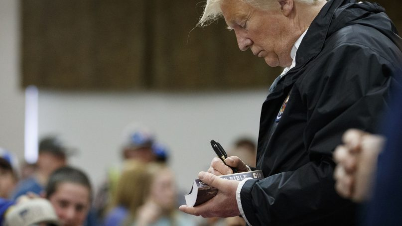 President Trump signs a Bible as he greets people at Providence Baptist Church in Smiths Station, Ala., on March 8, 2019. (AP Photo/Carolyn Kaster)