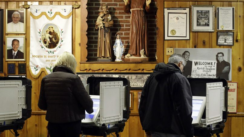 Voters cast their ballots at a polling place inside St. Leo's Catholic Church in Baltimore on Election Day,  Nov. 6, 2012. (AP Photo/Patrick Semansky)