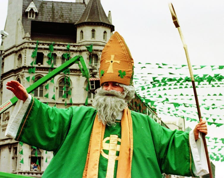 A man dressed as Saint Patrick blesses the crowd in Dublin as the parade makes its way through the Irish capital in 1998. AP Photo/John Cogill