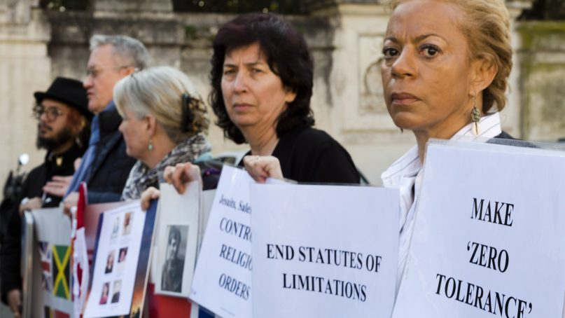 Psychoneurologist and founding member of the Ending Clergy Abuse (ECA) organization, Denise Buchanan, right, and member Leona Huggins, second from right, participate in a protest outside the St. Anselm on the Aventine Benedictine complex in Rome on the second day of a summit called by Pope Francis at the Vatican on sex abuse in the Catholic Church on Feb. 22, 2019. Pope Francis has issued 21 proposals to stem the clergy sex abuse around the world, calling for specific protocols to handle accusations against bishops and for lay experts to be involved in abuse investigations. (AP Photo/Domenico Stinellis)