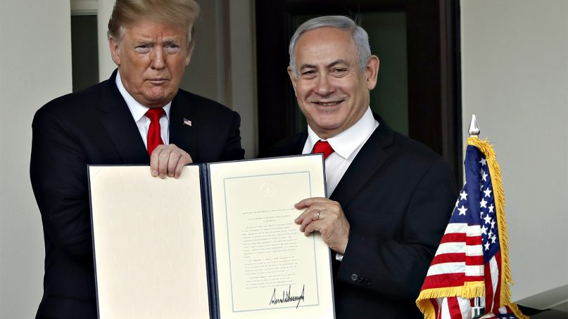 President Trump and Israeli Prime Minister Benjamin Netanyahu hold up a signed proclamation at the White House on March 25, 2019, in Washington. Trump signed an official proclamation formally recognizing Israel's sovereignty over the Golan Heights. (AP Photo/Jacquelyn Martin)