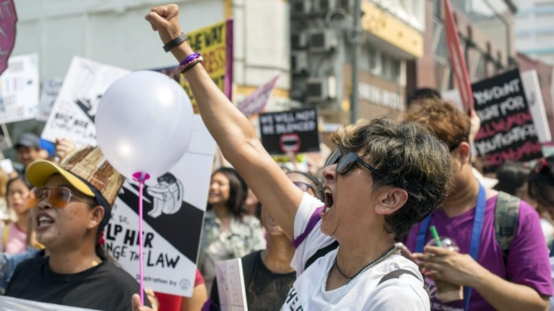 """Nadia Gideon, a Malaysian activist, participates in the women's march on March 9, 2019, in Kuala Lumpur. """"There are so many issues that were talked about, but the LGBT issues were singled out because our government did not have an answer on how to end child marriage or how to raise minimum wage,"""" she said in a Facebook post after the rally received backlash. RNS photo by Alexandra Radu"""