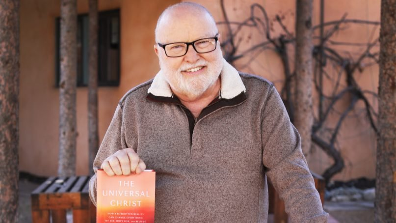 """Richard Rohr with his book """"The Universal Christ."""" Courtesy photo"""
