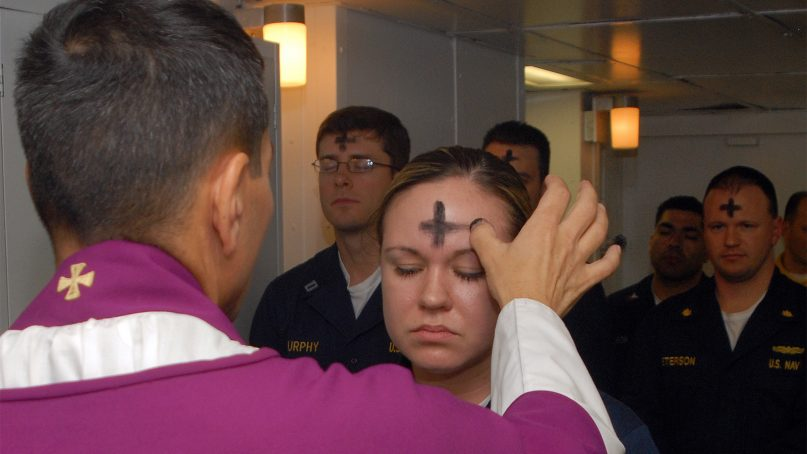 U.S. Navy employees receive ashes during an Ash Wednesday observance. Photo by Mass Communication Specialist 3rd Class Brian May/U.S. Navy/Creative Commons
