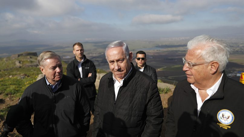 Israeli Prime Minister Benjamin Netanyahu, center, Republican U.S. Senator Lindsey Graham, left, and U.S. Ambassador to Israel David Friedman, right, visit the border between Israel and Syria at the Israeli-held Golan Heights, on March 11, 2019. Graham says he will push for American recognition of Israeli sovereignty over the Golan Heights, a territory it captured from Syria in the 1967 Mideast war. (Ronen Zvulun/Pool via AP)
