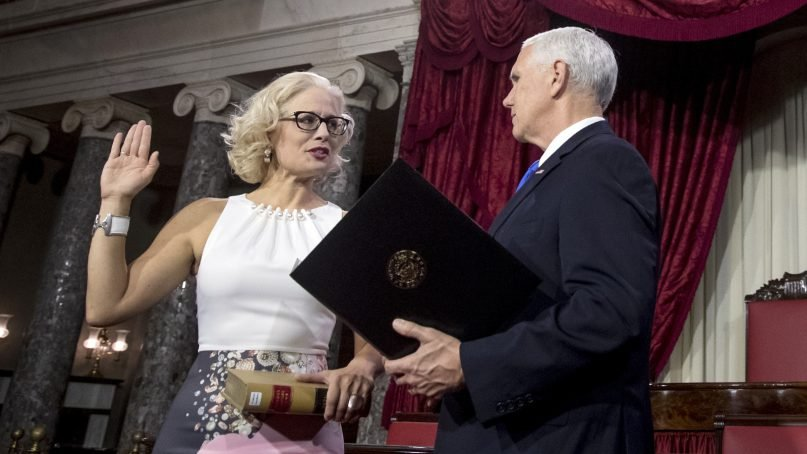 Vice President Mike Pence, right, administers the Senate oath of office to Sen. Kyrsten Sinema, D-Ariz., during a mock swearing in ceremony in the Old Senate Chamber on Capitol Hill in Washington, on Jan. 3, 2019, as the 116th Congress begins. (AP Photo/Andrew Harnik)