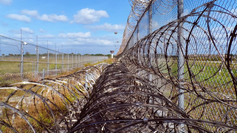 Layers of razor wire surround a prison. Photo courtesy of Creative Commons