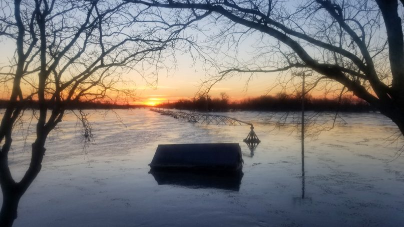 The sun rises over a flooded field in Columbus, Neb., shortly before nearby  residents were rescued from their home by helicopter. Photo courtesy of Shawn Vanderpool