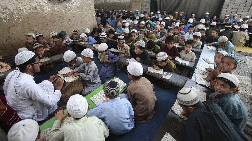 Pakistani Muslim students attend a madrassa to learn the Quran, in Karachi, Pakistan, on March 15, 2018. Religious schools in Pakistan, most of them in mosques, are the only source of education for millions of children. (AP Photo/Fareed Khan)