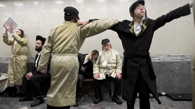 Ultra-Orthodox Jewish men celebrate after getting drunk during the Jewish holiday of Purim in Mea Shearim ultra-Orthodox neighborhood in Jerusalem, on March 13, 2017. The Jewish holiday of Purim celebrates the Jews' salvation from genocide in ancient Persia, as recounted in the Scroll of Esther. (AP Photo/Oded Balilty)