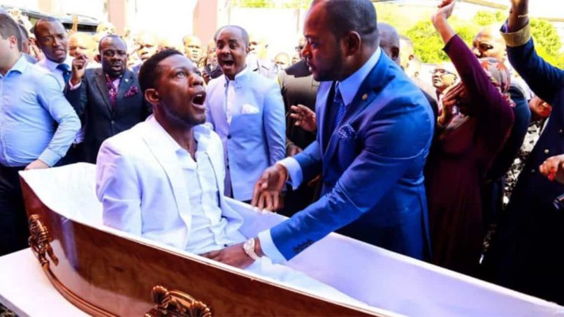 """Pastor Alph Lukau, right, alleged to resurrect """"Elliot"""" through God's work on Feb. 24, 2019, at Alleluia International Ministries in Johannesburg, South Africa. The claim has been disputed. Video screenshot"""