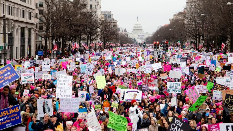 Several hundred thousand people participate in the Women's March on Washington on Jan. 21, 2017. An estimated 5 million people participated in coordinated marches worldwide. Photo by Vlad Tchompalov/Unsplash/Creative Commons