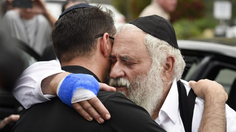 Rabbi Yisroel Goldstein, right, is hugged as he leaves a news conference at the Chabad of Poway synagogue, on April 28, 2019, in Poway, Calif. A man opened fire Saturday inside the synagogue near San Diego as worshippers celebrated the last day of Passover. (AP Photo/Denis Poroy)