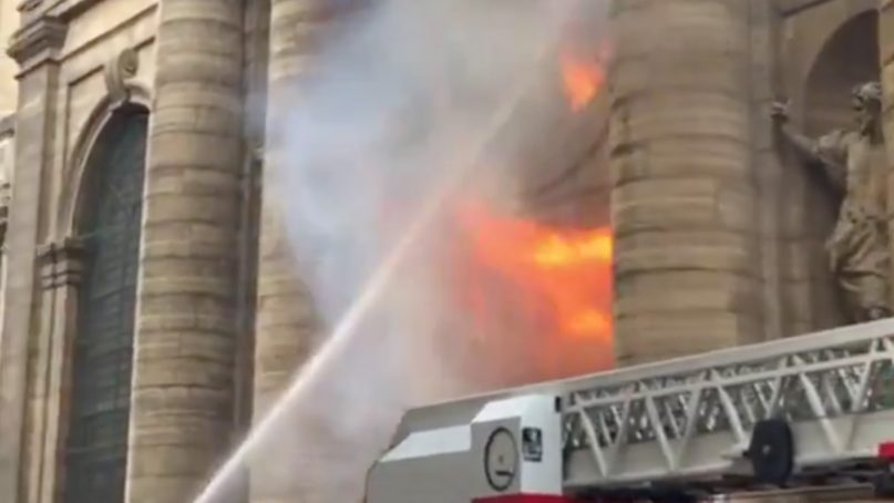 French firefighters extinguish flames during a recent fire at St. Sulpice Catholic Church in Paris. Video screenshot