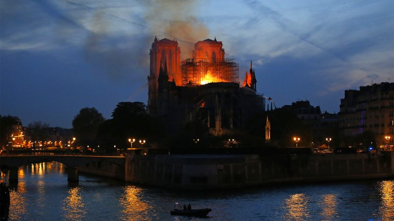 Firefighters tackle the blaze as flames and smoke rise from Notre Dame Cathedral as it burns in Paris on April 15, 2019. (AP Photo/Michel Euler)