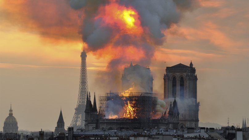 Flames and smoke rise from the blaze at Notre Dame Cathedral in central Paris on April 15, 2019. An inferno that raged through Notre Dame Cathedral for more than 12 hours destroyed its spire and its roof but spared its twin medieval bell towers, and a frantic rescue effort saved the monument's