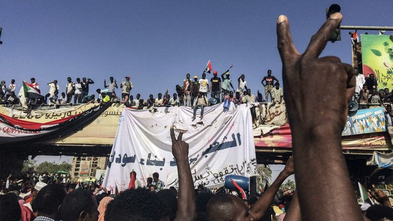Sudanese demonstrators rally to demand that a civilian body lead the transition to democracy, outside the army headquarters in Khartoum, the Sudanese capital, on April 13, 2019.  (AP Photo)