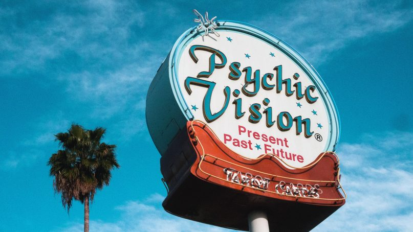 A sign for a psychic. Photo by Wyron A./Creative Commons