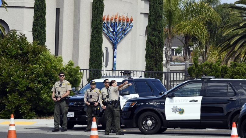 San Diego County sheriff deputies stand in front of the Chabad of Poway synagogue on April 28, 2019, in Poway, Calif. A man opened fire Saturday inside the synagogue near San Diego as worshippers celebrated the last day of Passover. (AP Photo/Denis Poroy)