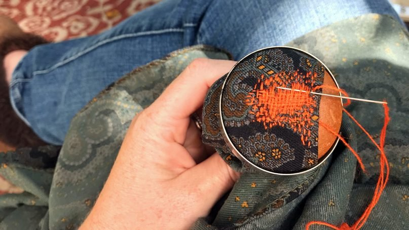 Making a visible mend in a scarf. Photo by Laura Everett