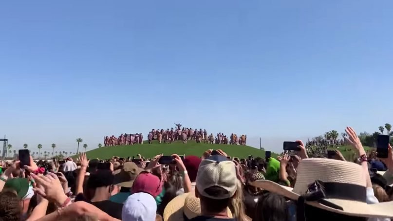 """Musician Kanye West headlined a """"Sunday Service"""" performance on a specially made hilltop stage at the Coachella Valley Music and Arts Festival on Easter Sunday, April 21, 2019, in Indio, Calif. Video screenshot"""