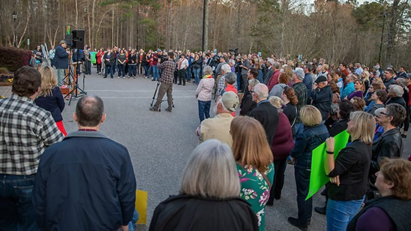 A group of clergy and laity in the United Methodist Church  North Carolina Conference gathered for a Rally of Inclusion in the parking lot of the conference office on March 28, 2019. Photo courtesy of UMC NC Conference