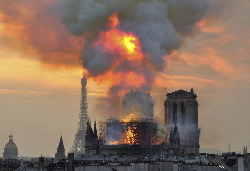 Flames and smoke rise from the blaze at Notre Dame Cathedral in central Paris on April 15, 2019. An inferno that raged through the cathedral for more than 12 hours destroyed its spire and its roof but spared its twin medieval bell towers, and a frantic rescue effort saved the monument's