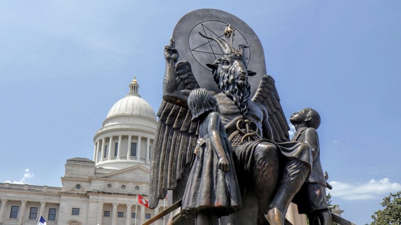 The Satanic Temple unveils its statue of Baphomet, a winged-goat creature, at a rally for the First Amendment in Little Rock, Ark., on Aug. 16, 2018. The Satanic Temple wants to install the statue on Capitol grounds as a symbol for religious freedom after a monument of the biblical Ten Commandments was installed in 2017. Photo courtesy of Magnolia Pictures