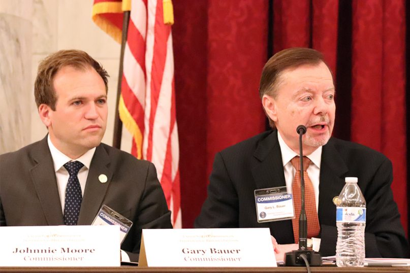 USCIRF commissioners Johnnie Moore, left, and Gary Bauer speak about the 2019 annual report during a news conference on April 29, 2019, in Washington. RNS photo by Adelle M. Banks