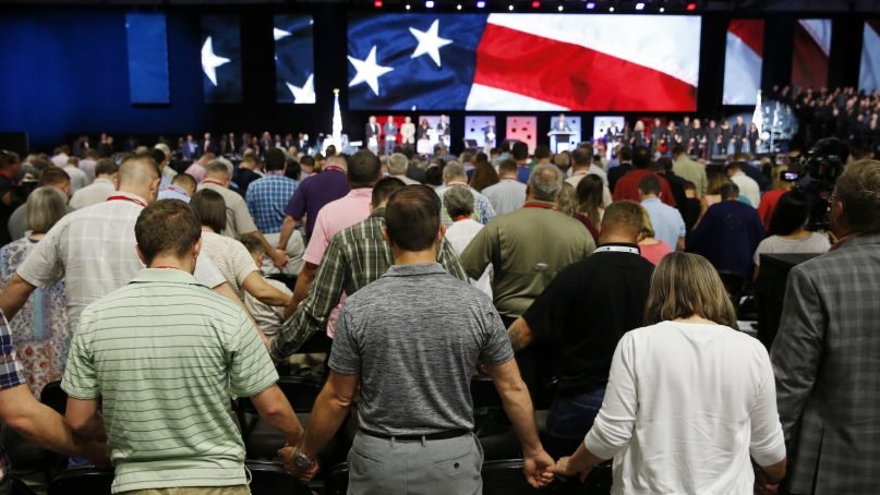 People pray for America at the 2018 Annual Meeting of the Southern Baptist Convention at the Kay Bailey Hutchison Dallas Convention Center in Dallas on Tuesday, June 12, 2018. (Vernon Bryant/The Dallas Morning News)
