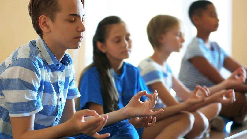 Yoga classes are becoming more prevalent in America's schools. Africa Studio via www.shutterstock.com