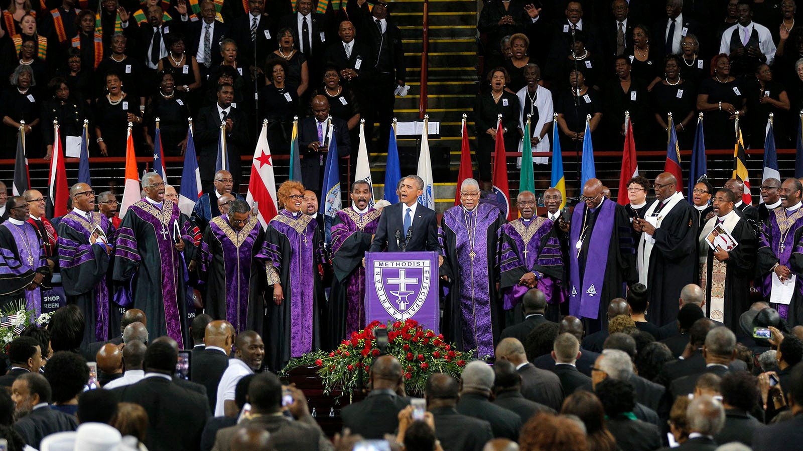 """U.S. President Barack Obama leads mourners in singing """"Amazing Grace"""" as he delivers a eulogy in honor of the Rev. Clementa Pinckney during funeral services for Pinckney in Charleston, S.C., on June 26, 2015. Pinckney was one of nine victims of a mass shooting at the Mother Emanuel AME Church. Photo by Brian Snyder/Reuters"""
