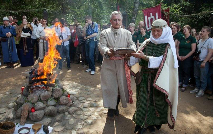 High Priestess Inija Trinkūnienė, right, celebrates Jorė, the first green grass festival of spring, in a Romuva village in Lithuania, on April 23, 2014. RNS photo by Vytas Daraškevičius