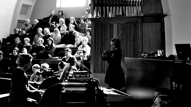 Musicians play during a church service. Photo by Paul Naude/Creative Commons