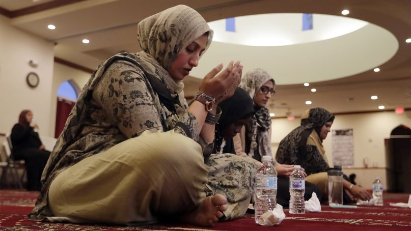 Women pray at the Islamic Center of Greater Miami, on May 8, 2019, in Miami Gardens, Florida. (AP Photo/Lynne Sladky)