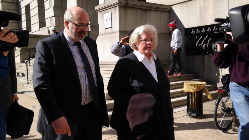 Heather Cook leaves Baltimore City Circuit Court in Baltimore with attorney Jose Moline after her arraignment on April 3, 2015. (AP Photo/Juliet Linderman)