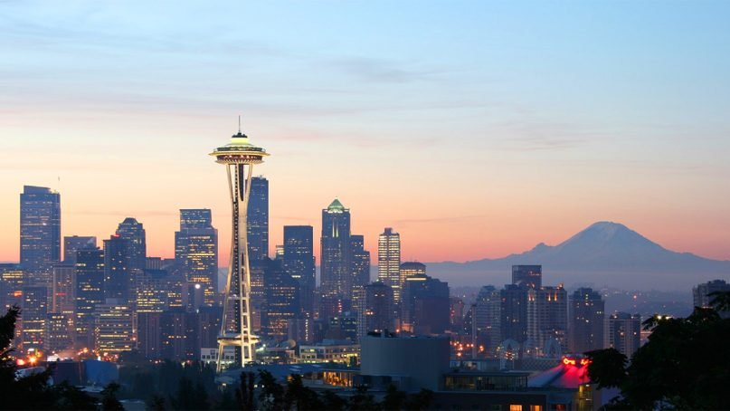 Mt. Rainier, right, looms beyond the Seattle skyline. Photo courtesy of Creative Commons