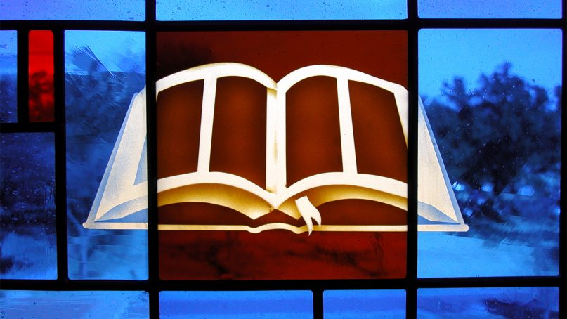 A detail of a Bible in a stained glass window by Don Young Glass Studio created for Southwestern Baptist Theological Seminary. Photo courtesy of Don Young Glass Studio
