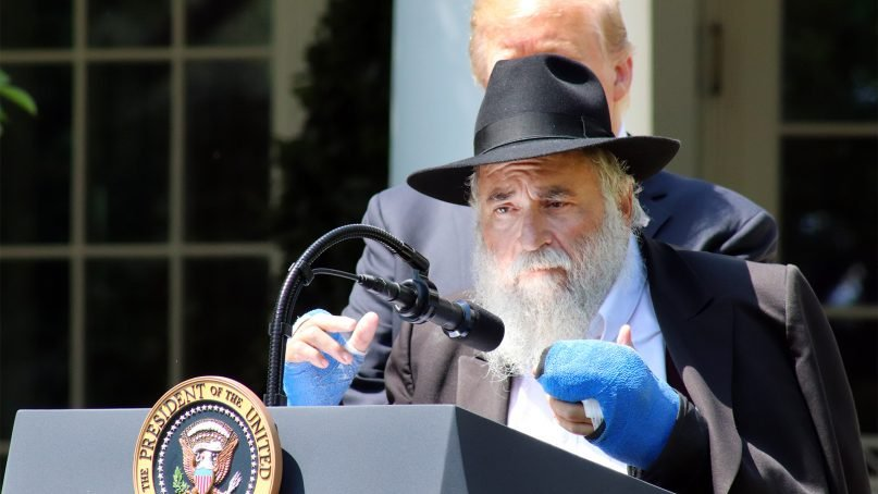 Rabbi Yisroel Goldstein speaks in front of President Trump during a National Day of Prayer event in the White House Rose Garden on May 2, 2019, in Washington. Goldstein, who leads the Chabad of Poway in San Diego, was injured when the synagogue was attacked by a gunman on April 27, 2019. RNS photo by Adelle M. Banks