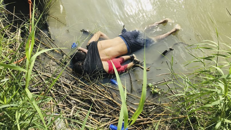 The bodies of Salvadoran migrant Óscar Alberto Martínez Ramírez and his nearly 2-year-old daughter, Valeria, lie on the bank of the Rio Grande in Matamoros, Mexico, on June 24, 2019, after they drowned trying to cross the river to Brownsville, Texas. Martínez's wife, Tania, told Mexican authorities she watched her husband and child disappear in the strong current. (AP Photo/Julia Le Duc)