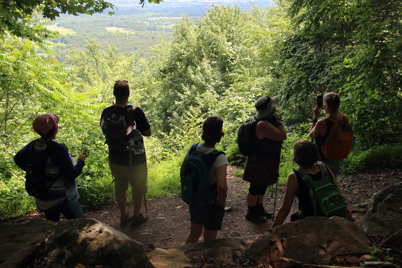 After climbing a ridge, pilgrims stop to rest  and enjoy the view on June 26, 2019, Day 4 of the Appalachian Camino, a weeklong pilgrimage organized by the Episcopal Diocese of Central Pennsylvania on parts of the Appalachian Trail passing through the diocese. RNS photo by Emily McFarlan Miller