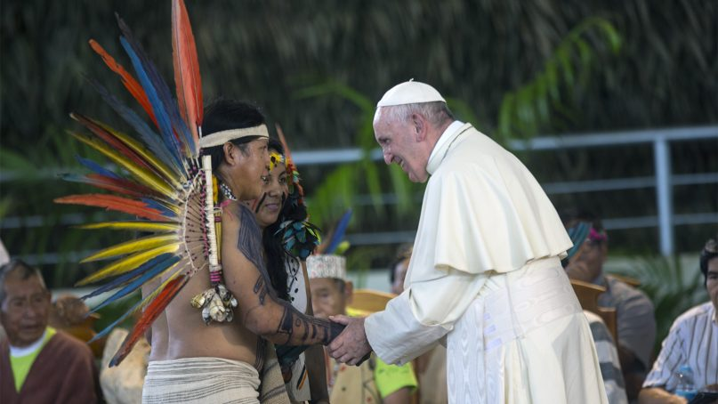 Pope Francis greets indigenous representatives in Puerto Maldonado, Peru, on Jan. 19, 2018. Standing with thousands of indigenous Peruvians, Francis declared the Amazon the