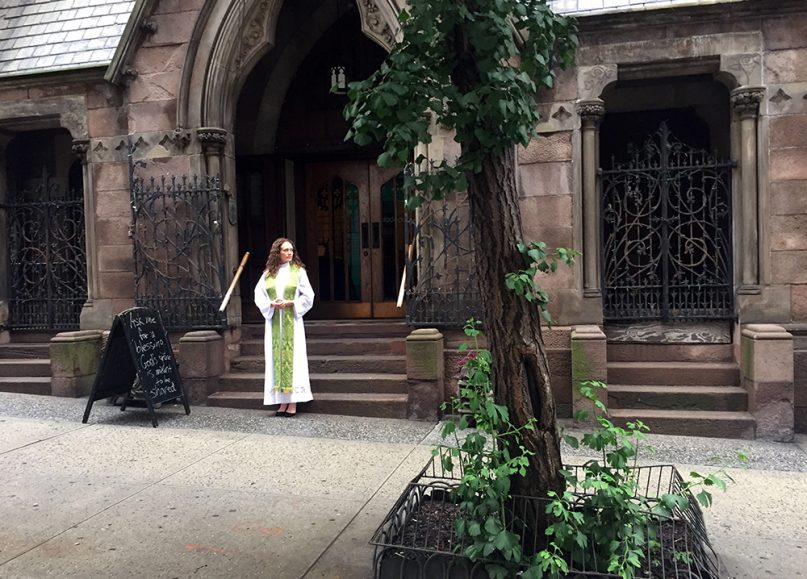 The Rev. Adrian Dannhauser stands outside Church of the Incarnation in New York City to offer a blessing to any interested individuals on June 25, 2019. Dannhauser offers blessings outside her church every Tuesday morning. RNS photo by Yonat Shimron