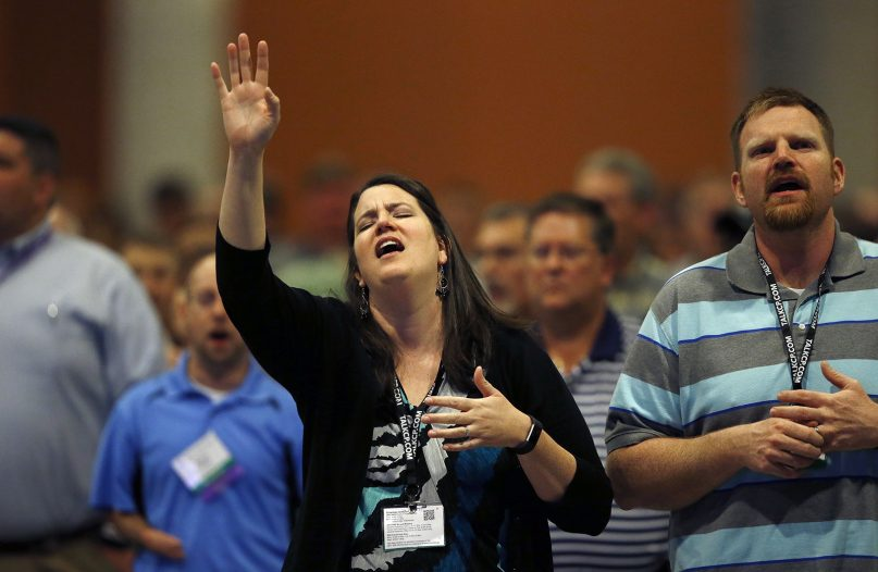 Members sing along to a song at the Southern Baptist Convention annual meeting on June 14, 2017, in Phoenix. (AP Photo/Ross D. Franklin)